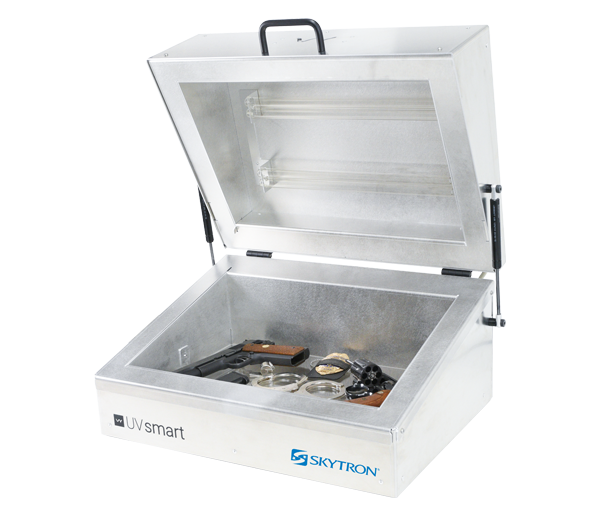 Skytron UV Smart counter top UVC disinfection device holding common correctional facility items